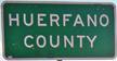 Huerfano County road sign